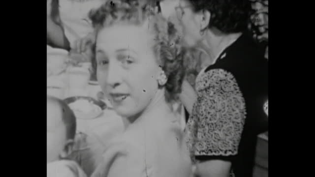 1948 home movie - family dinner on christmas eve - christmas meal stock videos & royalty-free footage