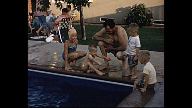 1958 home movie family picnic by the pool, children swimming, people in swim suits, teenage boy taking pictures - picnic stock videos & royalty-free footage