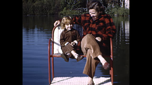 1955 home movie - family vacation by the lake - adirondack chair stock videos & royalty-free footage