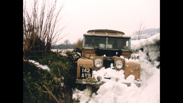 home movie footage circa 1963 known to be one of the united kingdom's coldest winters on record a series one land rover is loaded up with food to be... - land rover stock videos and b-roll footage