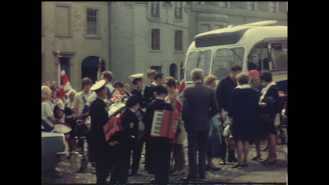 home movie footage from a march by the orange order of protestants in belfast, northern ireland circa 1964. - 社会史点の映像素材/bロール