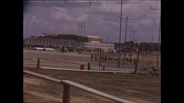 home movie footage of london heathrow airport including control tower circa 1970 - ヒースロー空港点の映像素材/bロール