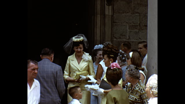 1966 home movie - groom and family on their way to church / wedding guests outside church - just married stock videos and b-roll footage