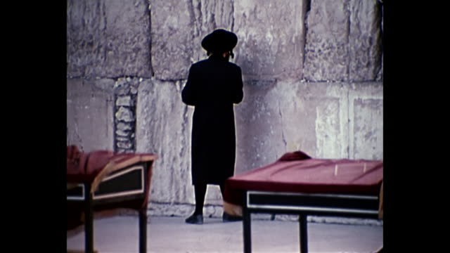 1969 home movie israel- man praying at wailing wall - jerusalem old city stock videos and b-roll footage