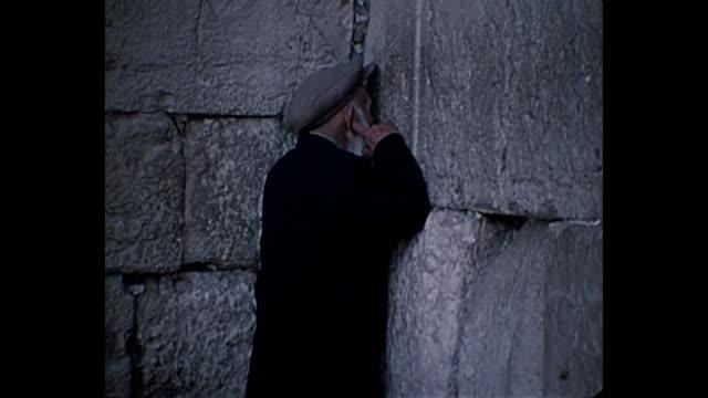 1969 home movie israel - various shots of young and old men at wailing wall - wailing wall stock videos & royalty-free footage