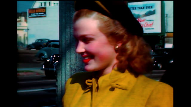 vidéos et rushes de home movie joan caulfield signing an autograph for a fan. nice her as she smiles to the camera. - actrice