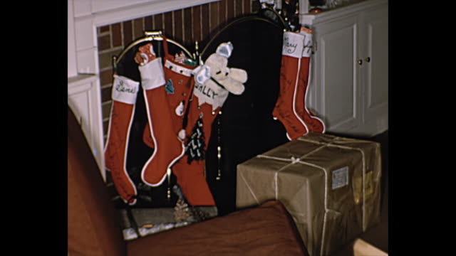 1962 home movie  - living room christmas decorations - stockings stock videos & royalty-free footage