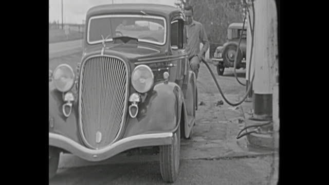 1934 home movie - man at gas station - petrol stock videos & royalty-free footage