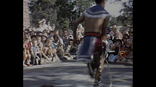 1966 home movie / man performs native american hoop dance - indigenous north american culture stock videos & royalty-free footage