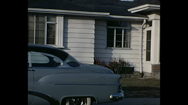 1953 Home Movie - Man showing his new Buick to friends