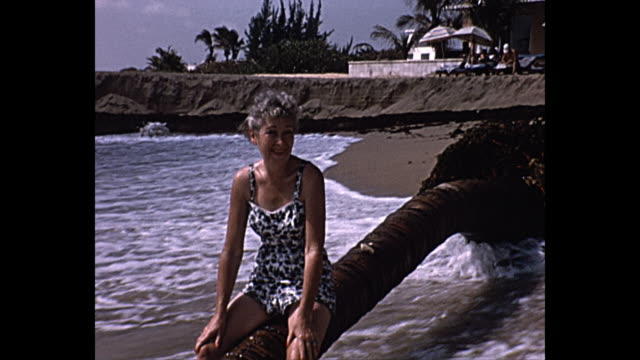 1958 home movie - mature woman in bathing suite - one mature woman only stock videos & royalty-free footage