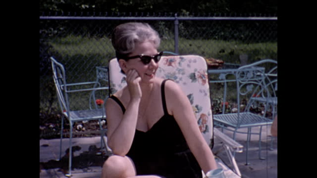 1963 Home Movie - matured people sun bathing by pool