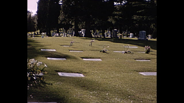 1957 home movie medium shot of cemetery - 1957 stock videos & royalty-free footage