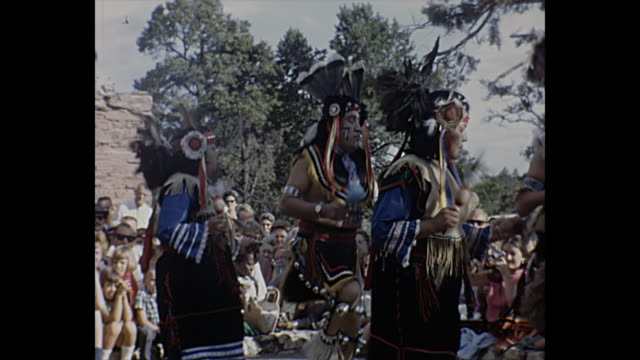 1966 Home Movie / Men and women perform Native American dance
