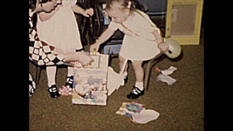 1972 home movie of 2 year old girls opening gifts with mom - sharing stock videos & royalty-free footage