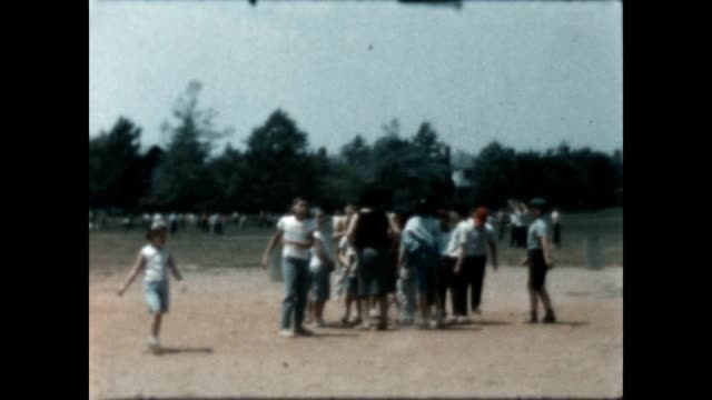 home movie of boys playing baseball in the park - home movie stock videos & royalty-free footage