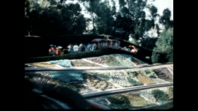 vídeos y material grabado en eventos de stock de home movie of casey jr circus train passing along followed by an interesting view of the cable cars and fantasyland - disneyland california
