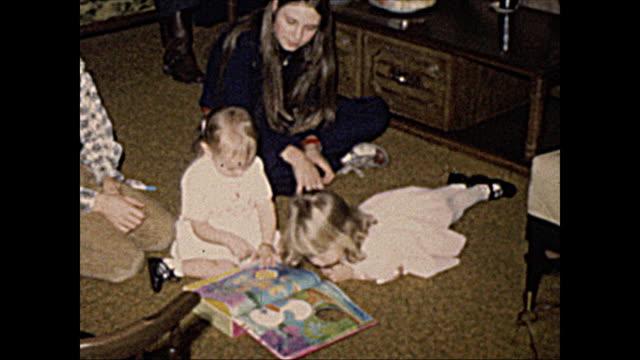1972 Home Movie of Children reading book
