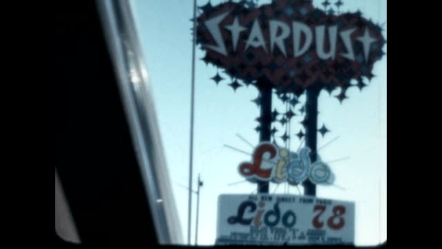 home movie of drive down the vegas strip with marquee's advertising a variety of acts including the lido from paris - 1978 stock videos & royalty-free footage