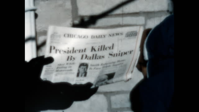 home movie of school children presenting the tragic news of president john f. kennedy's assassination as printed in the local chicago newspapers. - assassination of john f. kennedy stock videos & royalty-free footage
