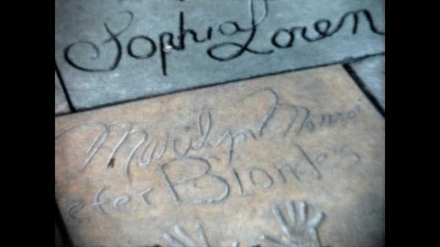 home movie of visit to the tcl chinese theatre and the various handprints of celebrities enshrined in concrete - sophia loren stock videos & royalty-free footage