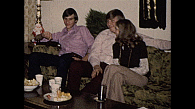 1972 home movie of young adults at birthday party - domestic room stock videos & royalty-free footage
