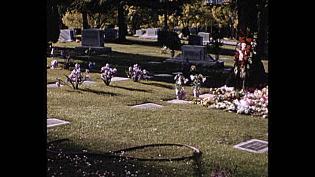 1957 home movie pan shot of cemetery - 1957 stock videos & royalty-free footage