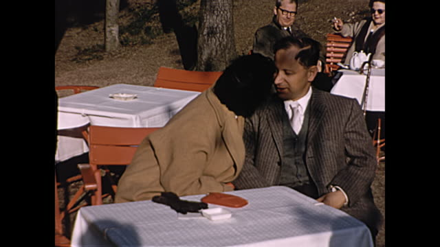 1957 home movie paris france - woman gives man a kiss while at table - 1957 stock videos & royalty-free footage