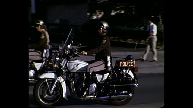 1980 home movie - police officers on motorcycles - parade stock videos & royalty-free footage