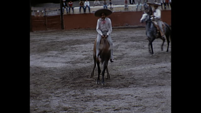 stockvideo's en b-roll-footage met 1963 home movie - rodeo bull riding show in oaxaca, mexico - cowboyhoed