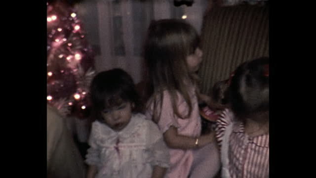 1973 home movie - santa claus passes out gifts - home movie stock videos & royalty-free footage