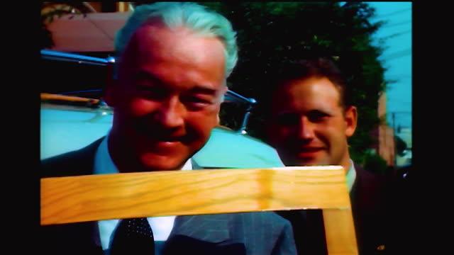 vídeos y material grabado en eventos de stock de home movie shot of william boyd holding a picture frame 1940s - william boyd