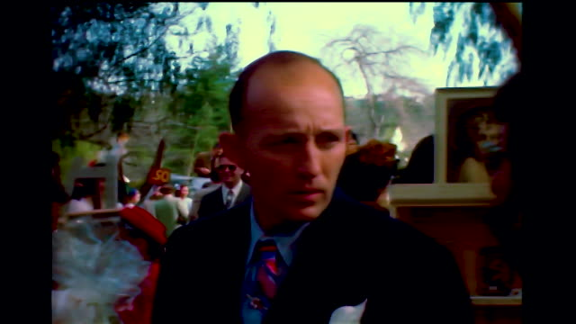 stockvideo's en b-roll-footage met home movie side view of bing crosby with his toupee shaking hands with people at an outdoor party. - bing crosby