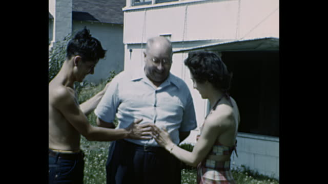 1952 home movie - teenagers tease grandfather - 1952 stock videos & royalty-free footage