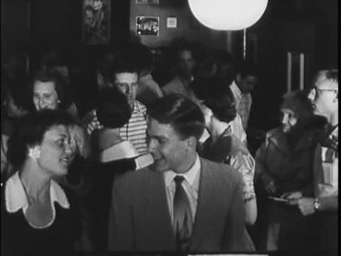 vídeos de stock, filmes e b-roll de home movie that captures footage of an audience as they leave a theater - 1960