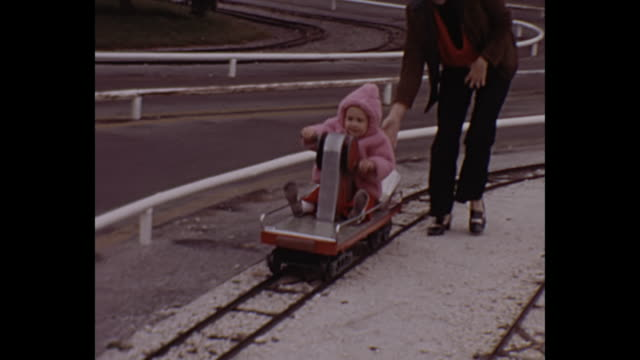 1972 home movie - toddler girl riding miniature train cart - home movie stock videos & royalty-free footage