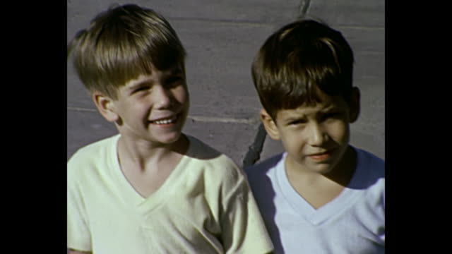 1980 home movie - two boys pose for camera - 1980 stock videos and b-roll footage