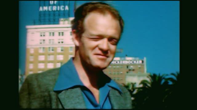home movie cu of van heflin with bank of america sign behind him - bank of america stock videos & royalty-free footage
