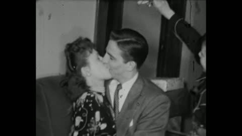 1948 home movie - various clips of couples kissing under the mistletoe - kissing stock videos & royalty-free footage
