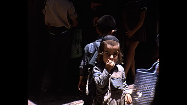 stockvideo's en b-roll-footage met 1968 home movie -  various shots of children in israel - orthodox jodendom