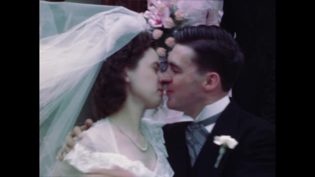 1947 home movie wedding - newlywed couple kiss outside of church - guest stock videos & royalty-free footage