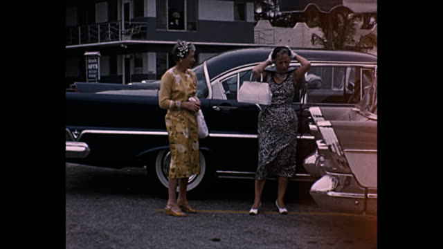1958 home movie - well dressed women pose for camera - 1958 stock videos and b-roll footage