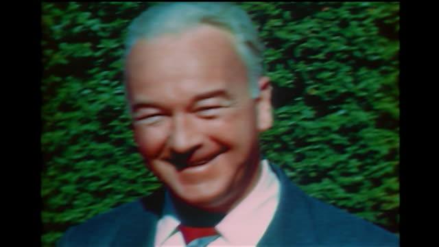 vídeos y material grabado en eventos de stock de home movie william boyd as he smiles for the camera. - william boyd