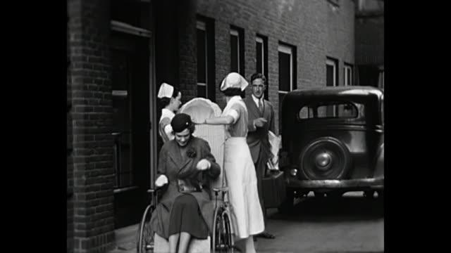 1931 home movie - woman with newborn - krankenpflegepersonal stock-videos und b-roll-filmmaterial