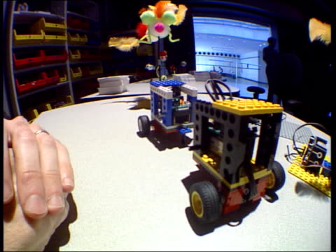 home of the future; massachusetts: interior of hall at massachusetts institute of technology toys made from construction blocks moving with the aid... - massachusetts video stock e b–roll