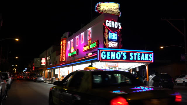 geno's steaks - home of the philly cheesesteak - philadelphia pennsylvania video stock e b–roll