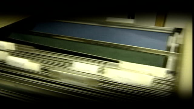 plans to divide department in two graphicised sequence filing cabinet drawer being opened / piece of paper being filed dissolve to **campbell... - itv weekend evening news stock-videos und b-roll-filmmaterial