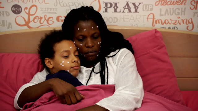 home quarantine.mother and daughter have a chickenpox - skin stock videos & royalty-free footage