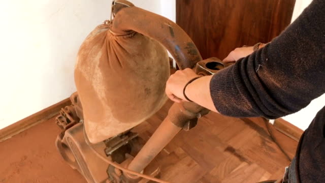 home renovations close up dusty bag on old floor sanding machine - sander stock videos and b-roll footage