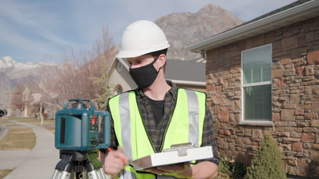home repairman wearing a face mask for protection - inspector stock videos & royalty-free footage